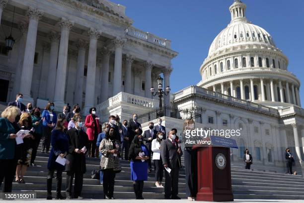 Speaker of the House Rep. Nancy Pelosi speaks as other House Democrats listen during a news conference on the For the People Act at the east front of...