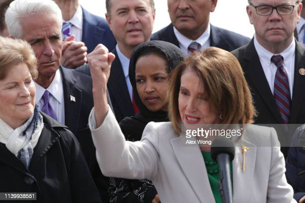 S Speaker of the House Rep Nancy Pelosi speaks as Rep Ilhan Omar and other congressional Democrats listen during a news conference in front of the US...