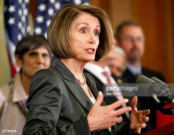 S Speaker of the House Rep Nancy Pelosi speaks as Rep Rosa DeLauro listens during a news conference March 16 2010 on Capitol Hill in Washington DC...