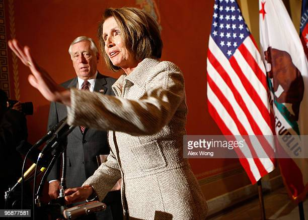 S Speaker of the House Rep Nancy Pelosi speaks to the media as House Majority Leader Rep Steny Hoyer listens during a press availability January 19...