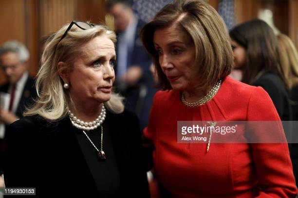 Speaker of the House Rep. Nancy Pelosi talks to Rep. Debbie Dingell after an event at the Rayburn Room of the U.S. Capitol December 19, 2019 in...