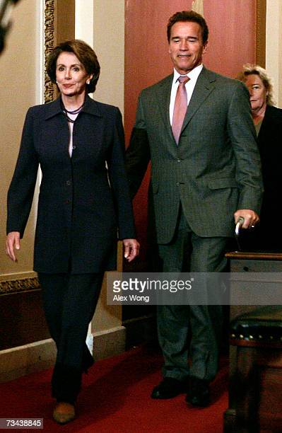 S Speaker of the House Rep Nancy Pelosi walks with California Gov Arnold Schwarzenegger toward the podium for a briefing after their meeting February...