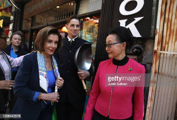 S Speaker of the House Rep Nancy Pelosi walks with her son Paul Pelosi Jr and Florence Fang as they tour San Francisco's Chinatown on February 24...