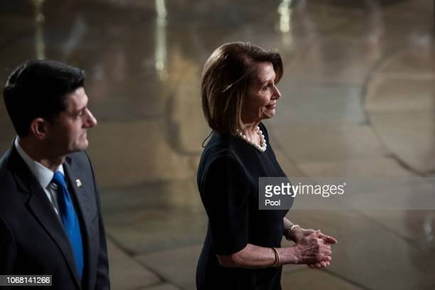 Speaker of the House Rep Paul Ryan and US House Minority Leader Rep Nancy Pelosi walk away after paying their respects to former US President George...