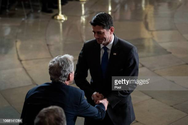Speaker of the House Rep Paul Ryan greets Former US President George W Bush during a ceremony for former US President George HW Bush at the US...
