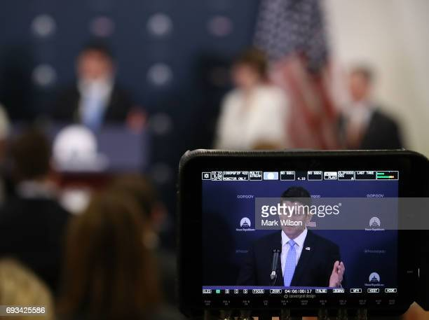 S Speaker of the House Rep Paul Ryan is seen on a monitor speaking to the media after attending the weekly House Republicans party conference on...