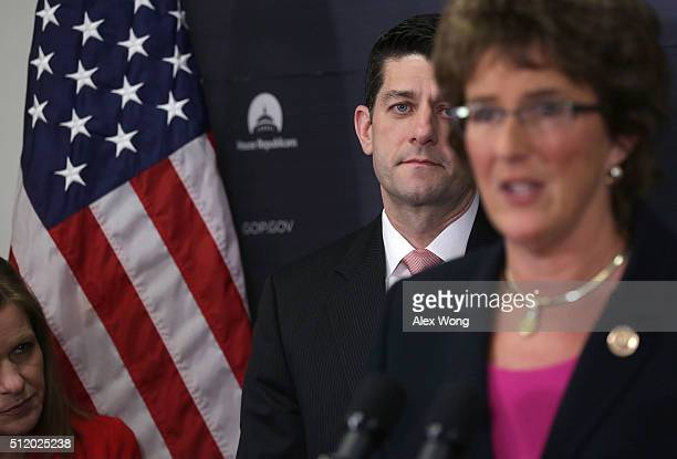 Speaker of the House Rep Paul Ryan listens to US Rep Jackie Walorski speak as House Republican Conference Vice Chair Rep Lynn Jenkins looks on during...