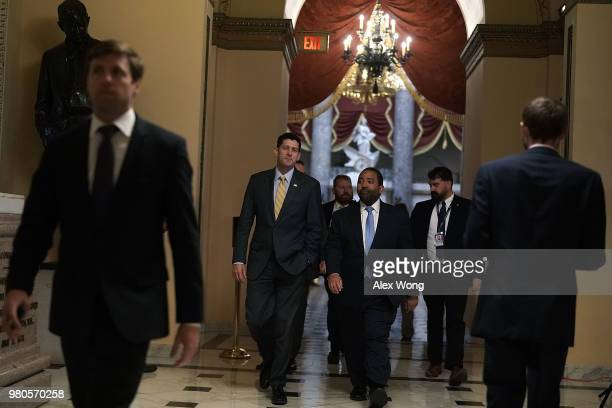 S Speaker of the House Rep Paul Ryan passes through a hallway at the US Capitol prior to a vote June 21 2018 in Washington DC Due to the defeat of a...