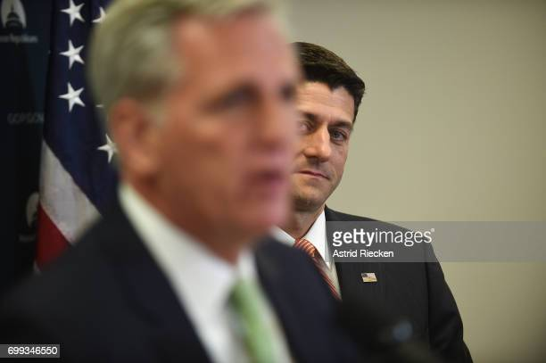 S Speaker of the House Rep Paul Ryan right watches House Majority Leader Kevin McCarthy speak to the media on Capitol Hill after their weekly party...
