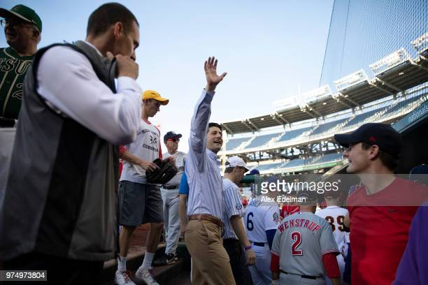 Speaker of the House Rep Paul Ryan waves to fans from the Republican dugout prior to the Congressional Baseball Game on June 14 2018 in Washington DC...