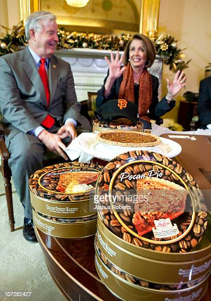 Speaker of the House Speaker Rep Nancy Pelosi reacts as she receives pecan pies from Rep Joe Barton to settle a bet after the San Francisco Giants...