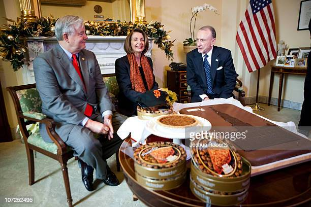 Speaker of the House Speaker Rep Nancy Pelosi receives pecan pies from Rep Joe Barton and a giant Hershey bar from Rep Arlen Specter to settle a bet...