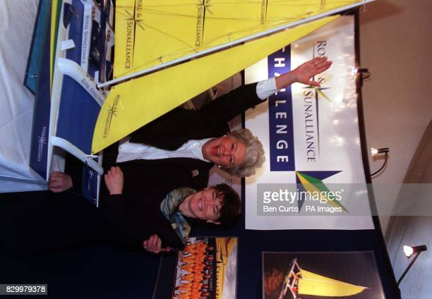 Speaker of the House the Rtn Hon Betty Boothroyd points her hand towards a model of the 92ft catamaran Royal SunAlliance on board which yachtswoman...