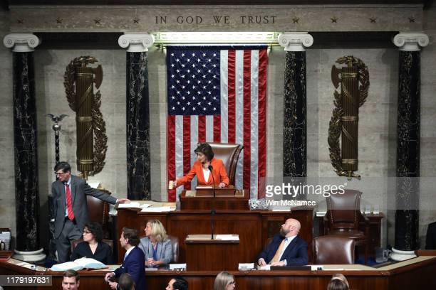 Speaker of the House, U.S. Rep. Nancy Pelosi presides over the U.S. House of Representatives as it votes on a resolution formalizing the impeachment...