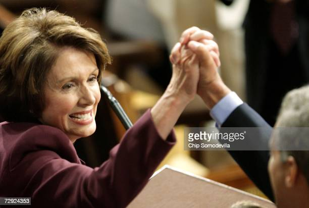 Speaker of the Houseelect Nancy Pelosi grabs the hand of Rep Rahm Emanuel while being nominated as the next Speaker of the House during a swearing in...