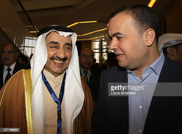 Speaker of the Kuwaiti National Assembly Jassem alKharafi speaks with Hassan Fadallah a member of the Lebanese parliament as he arrives for the...