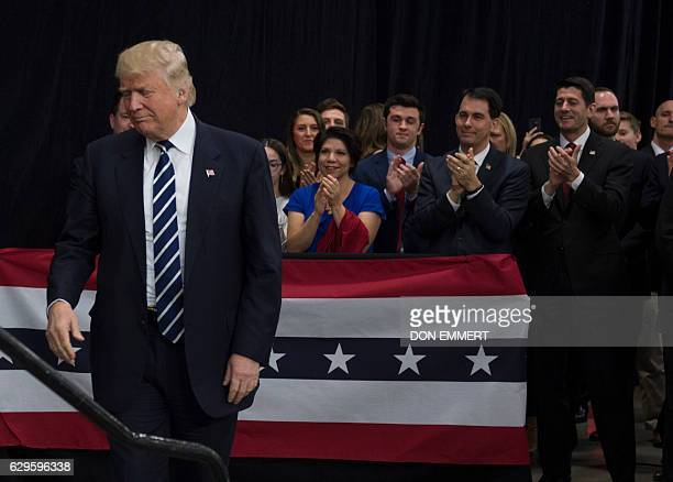 Speaker of the United States House of Representatives Paul Ryan and Wisconsin Governor Scott Walker applaud as President-elect Donald Trump arrives...