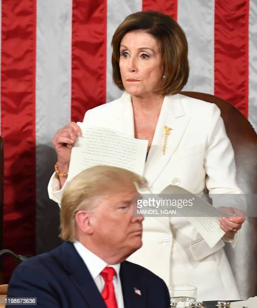 Speaker of the US House of Representatives Nancy Pelosi appears to rip a copy of US President Donald Trumps speech after he delivers the State of the...