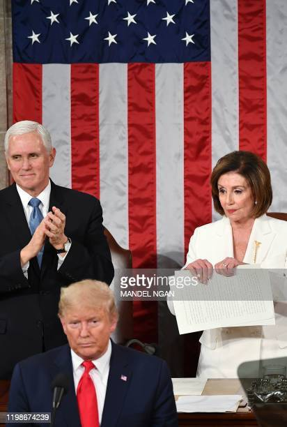Speaker of the US House of Representatives Nancy Pelosi rips a copy of US President Donald Trumps speech after he delivered the State of the Union...