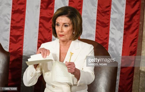 Speaker of the US House of Representatives Nancy Pelosi rips a copy of US President Donald Trumps speech after he delivers the State of the Union...