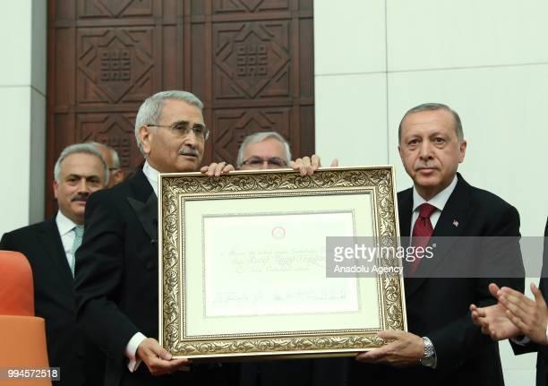 Speaker of Turkish Grand National Assembly Durmus Yilmaz presents certificate of election to Turkish President Recep Tayyip Erdogan after Erdogan...