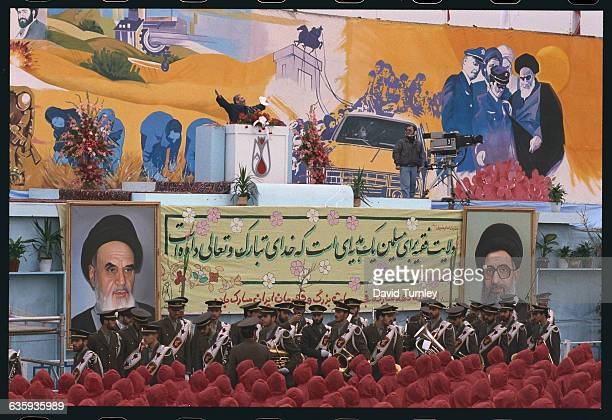 A speaker on the podium at a rally commemorating the 14th anniversary of the Iranian Revolution