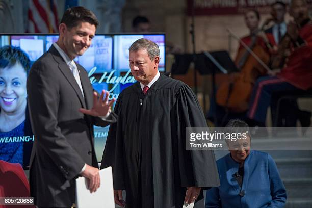 Speaker Paul Ryan, R-Wis., Chief Justice John Roberts, and Carla Hayden attend her swearing-in ceremony as Librarian of Congress in the Great Hall of...