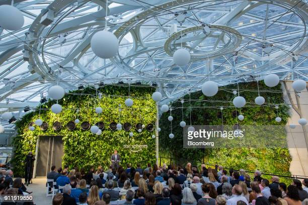 A speaker presents to visitors on the top floor of the Amazoncom Inc Spheres during opening day ceremonies at the company's campus in Seattle...