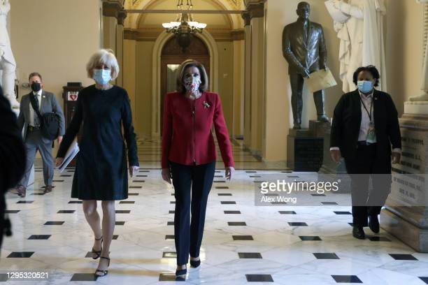 Speaker Rep. Nancy Pelosi walks with 60 Minutes correspondent Lesley Stahl of CBS News in a hallway at the U.S. Capitol January 8, 2021 in...