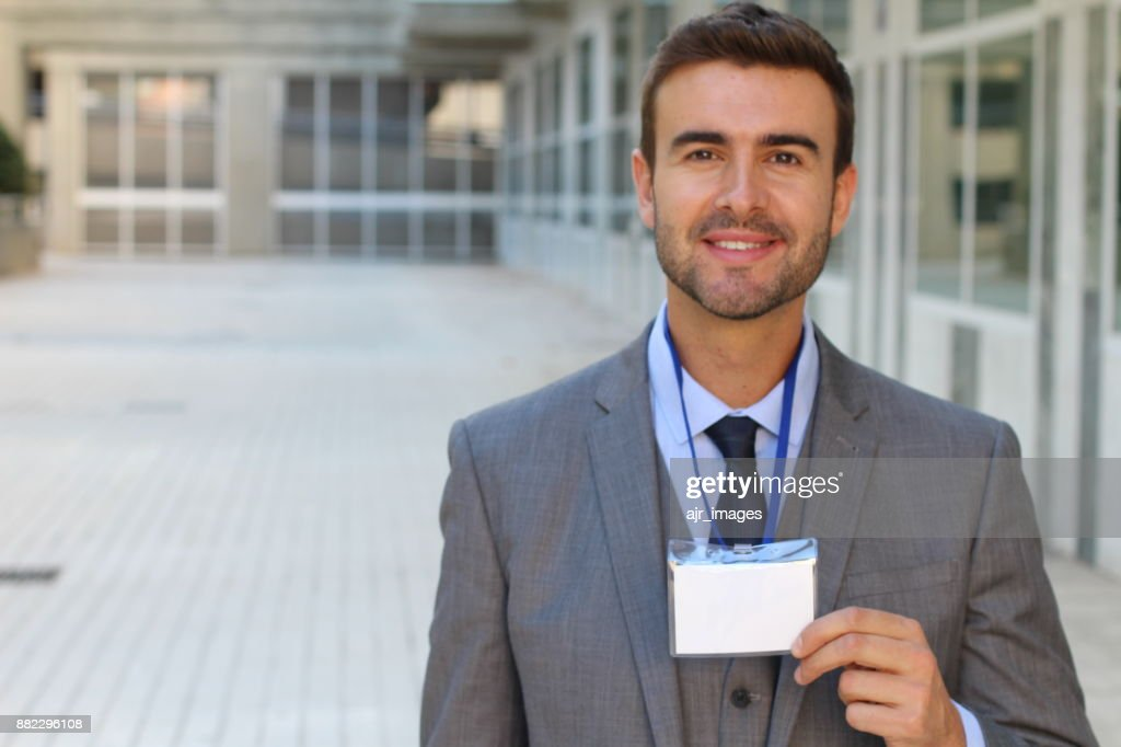 Speaker showing his id badge : Stock Photo