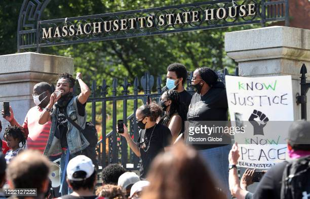 Speakers at the State House included Monica Cannon-Grant, right, and Eric Garner, Jr., second from right, during a protest march in honor of Rayshard...
