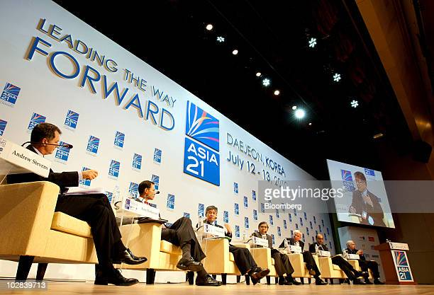 Speakers attend a conference hosted by South Korea's government and the International Monetary Fund in Daejeon, South Korea, on Tuesday, July 13,...