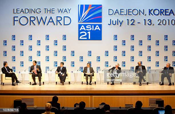 Speakers attend a conference hosted by South Korea's government and the International Monetary Fund in Daejeon South Korea on Tuesday July 13 2010...