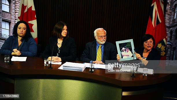 Speaking at a press conference l to r Miranda FerrierJennifer Burgess Bob Gadsby listen to Helen Benoit as she holds up a picture of her momAspasia...