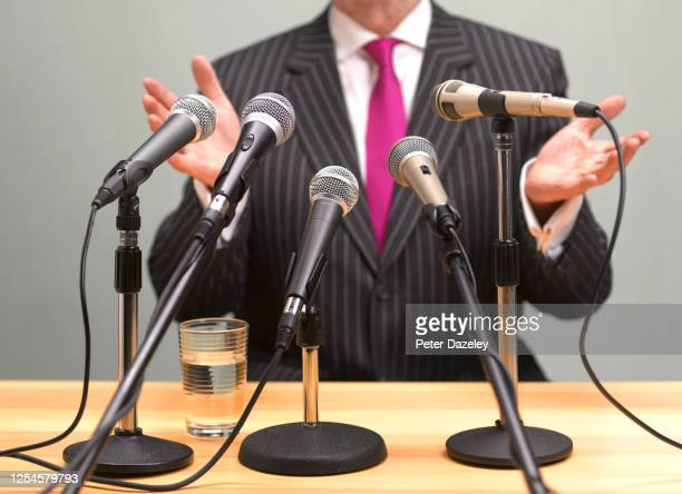 speaking to press with hands up - confession law stock pictures, royalty-free photos & images