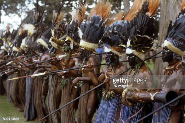 A spear carrying line up of tribesmen with a tomtom like instrument held by one of the men during the Singsing held at the Old Golf course Mt Hagen...