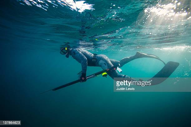 Spear diver hunting in the open ocean