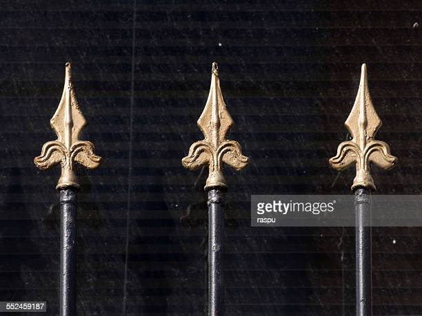A spears shape golden fence.