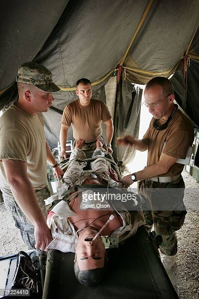 Spec Chris Pierce of Graceville Florida Sgt Jason Meeks of Belleview Florida and 1st Lt Lee Percy of Pensacola Florida work on a simulated casualty...