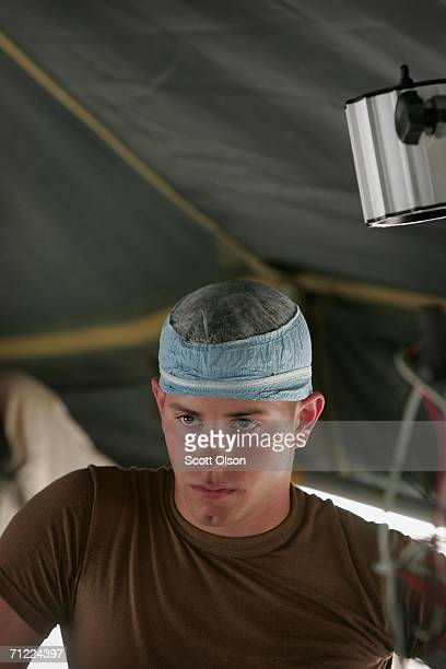 Spec Kyle Carpenter of Mobile Alabama listens to a critique of his performance after working on a simulated casualty during training with the 946th...