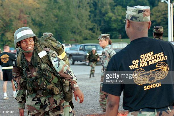 Spec Yvonne Caldwell finishes a grueling 12-mile road march with full pack and weapon, the last phase of the 101st Airborne Division's Air Assault...