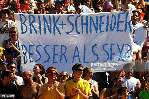Specatators display there sympathy during the half-final match between Julius Brink and Kjell Schneider of Germany against Sascha Heyer and Paul...