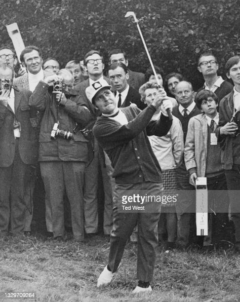Specatators look on as Gary Player of South Africa plays an iron shot out of the rough on the 1st during the Piccadilly World Match Play Championship...