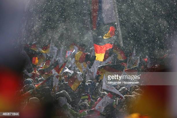 Specators celebrate at finish arena on day 2 of the Four Hills Tournament Ski Jumping event at SchattenbergSchanze Erdinger Arena on December 28 2014...