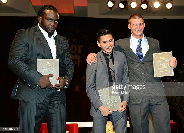 Special achievement award winners WBC heavyweight champion Bermane Stiverne and college boxers Vinh Thai and Garrett Felling pose with their awards...