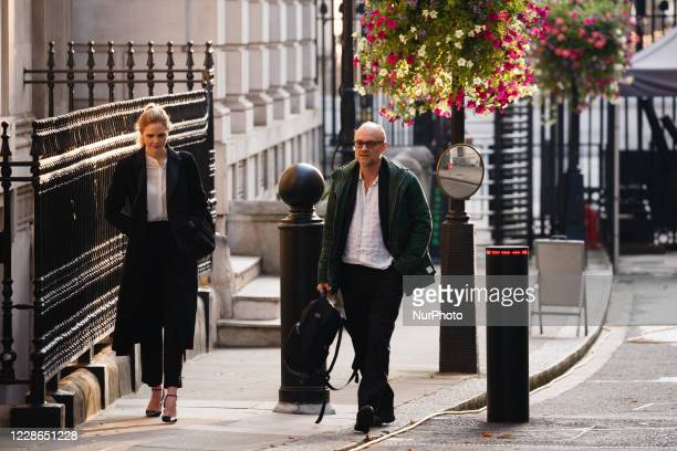 Special advisors Dominic Cummings and Cleo Watson arrive on Downing Street ahead of the weekly cabinet meeting in London England on September 22 2020