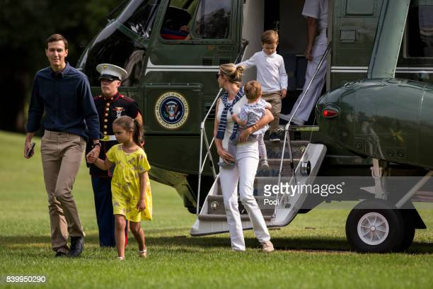Special Advisors Jared Kushner and Ivanka Trump with their children Arabella Joseph and Theodore 1 exit Marine One on the South Lawn August 27 2017...