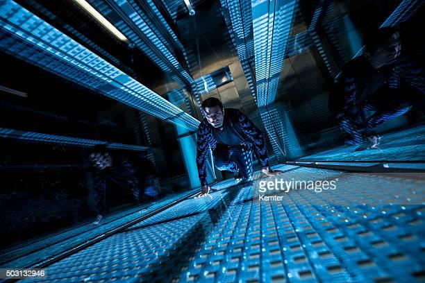 special agent crawling in a dark corridor