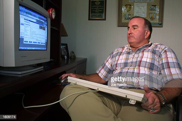 Special Agent Don Condon from the Florida Department of Law Enforcement uses an AOL account on his computer August 14, 2001 to bring online...