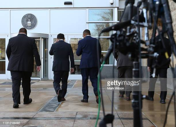 Special Agent Gordon Johnson US Attorney Robert Hur and Art Walker of the Coast Guard Investigative Service walk away after speaking to the media...